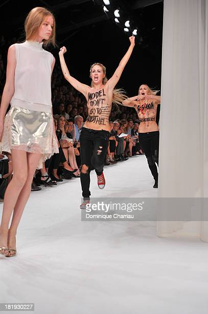 A topless Femen activist disrupts the Nina Ricci show during Paris Fashion Week Womenswear Spring/Summer 2014 on September 26 2013 in Paris France