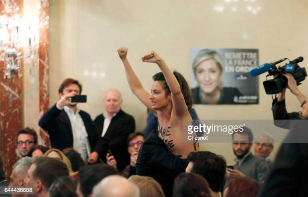 A topless Femen activist protests as the Leader of France's farright Front National political party and candidate for the 2017 French presidential...