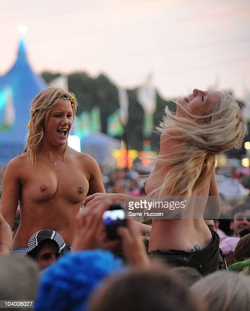 Topless girls in the crowd enjoy the festival on day two of Bestival on September 11 2010 on the Isle of Wight United Kingdom