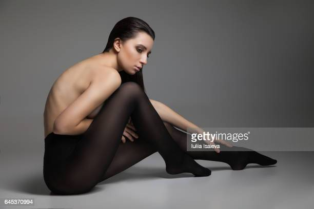 topless lady in black pantyhose - nylon feet stock photos and pictures