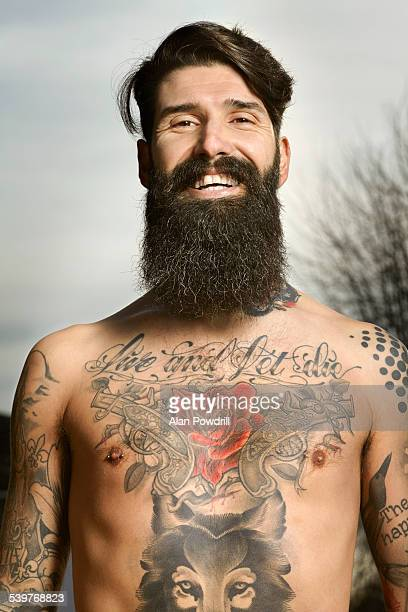 Topless male portrait with tattoos