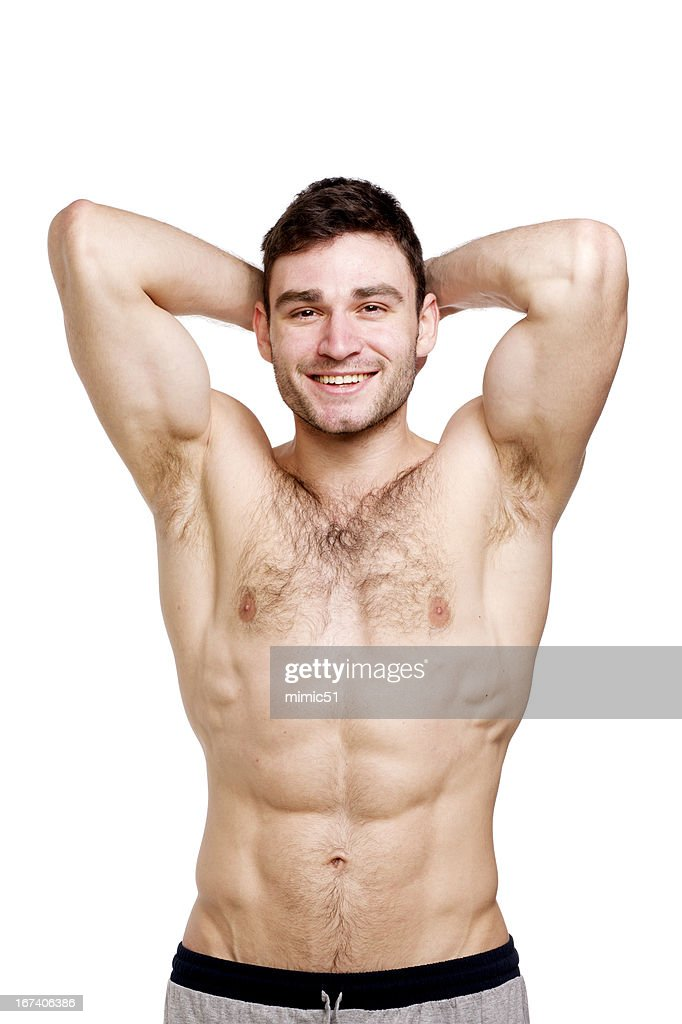 Topless man stood isolated on a white background : Stock Photo
