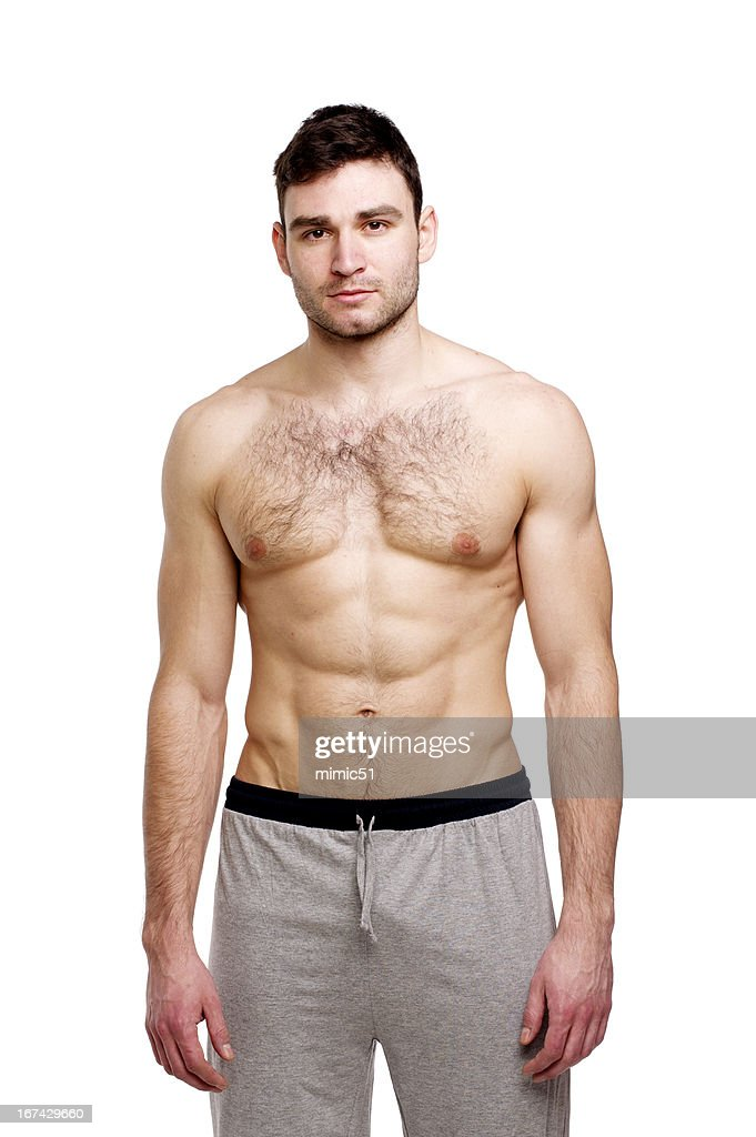 Topless man stood on a white background : Stock Photo