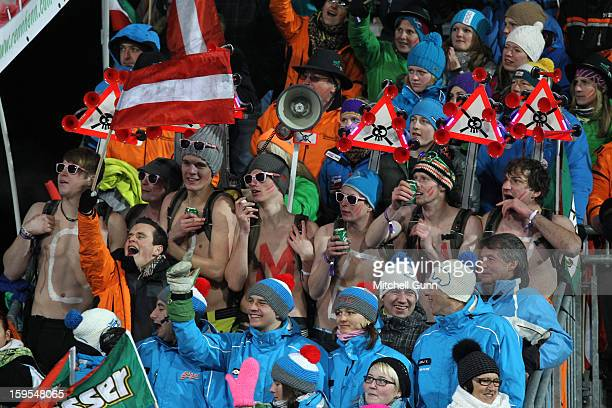 Topless members of the Carmen Thalmann fan club watch from the stands during the Audi FIS Alpine Ski World Cup Slalom race on January 15 2013 in...