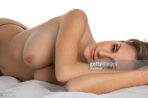 Topless on a bed