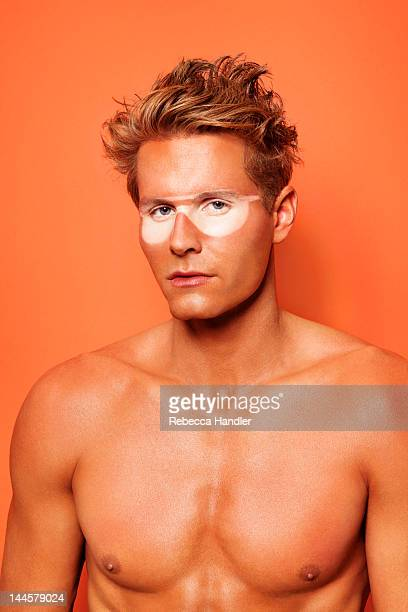 Topless Sunburnt Man with Sunglass Tan Lines