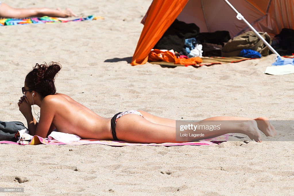 Topless Tanning On The Beach In Cannes May 2011