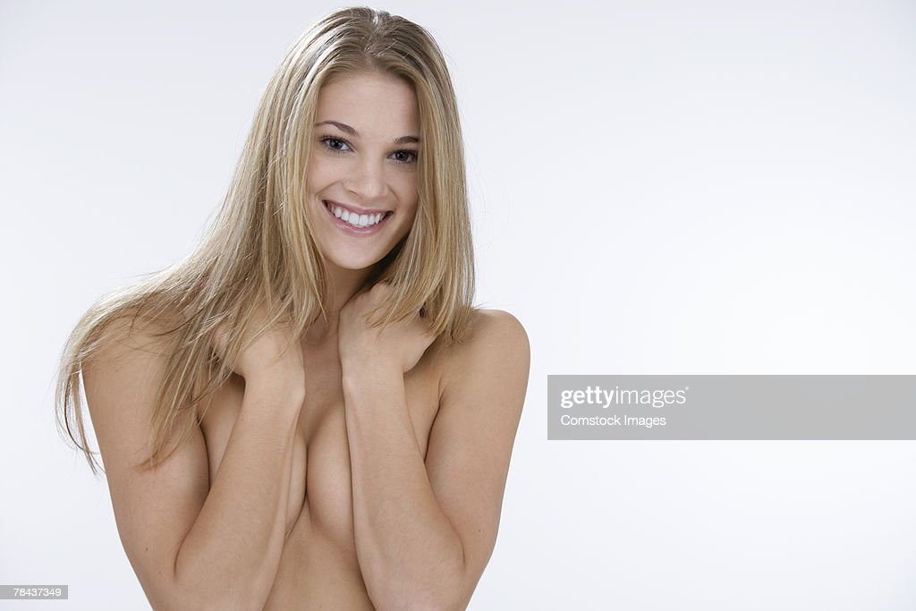 Topless woman covering herself : Stockfoto