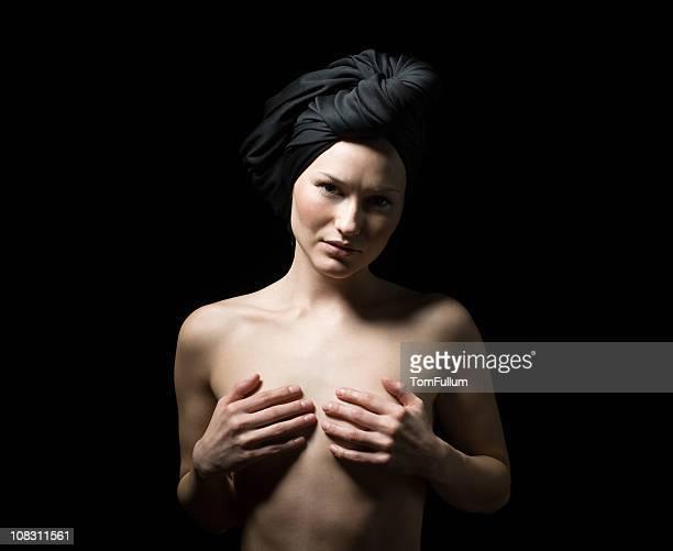 Topless Woman in Black Headscarf