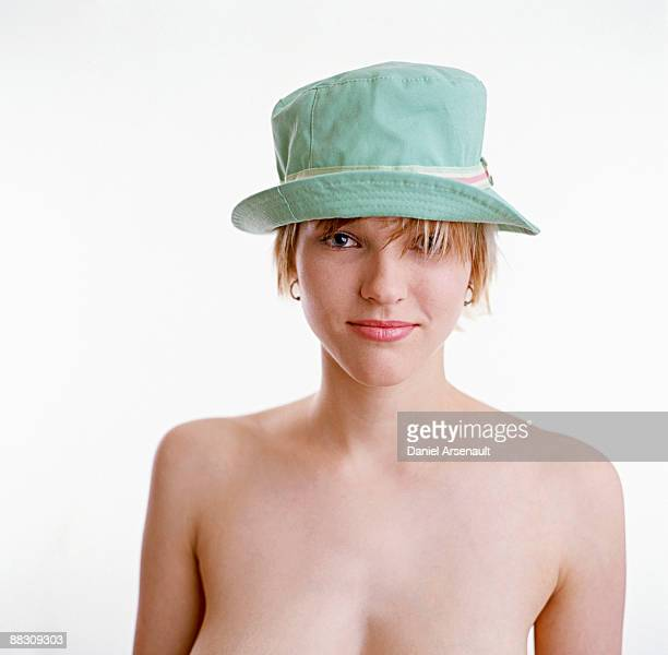 Topless woman in hat