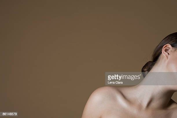 a topless woman leaning - oben ohne frau stock-fotos und bilder