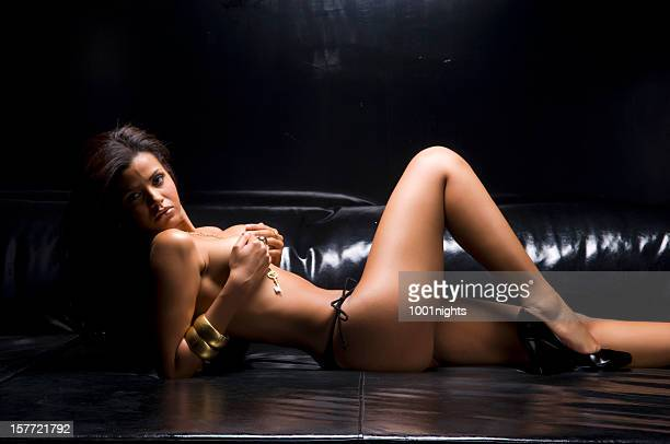 topless woman on the sofa - topless bikini models stock pictures, royalty-free photos & images
