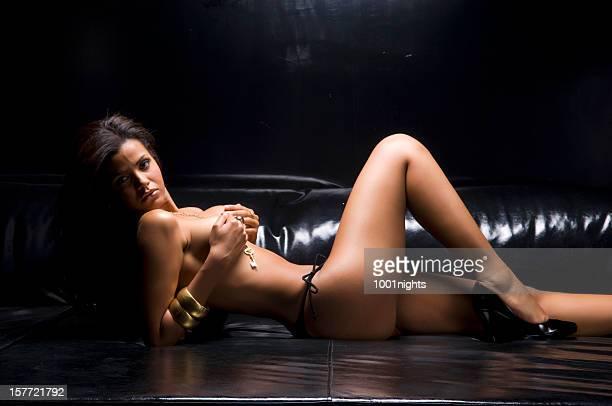 topless woman on the sofa