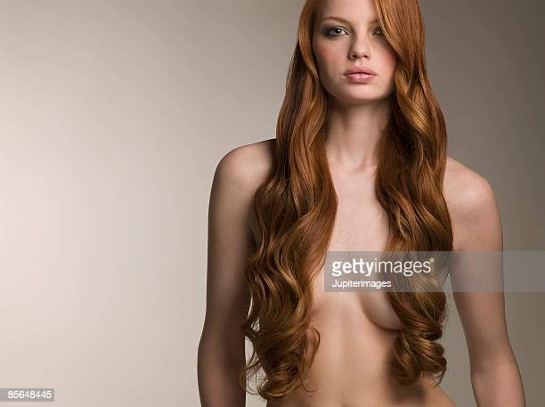 Topless woman with smooth curly hair