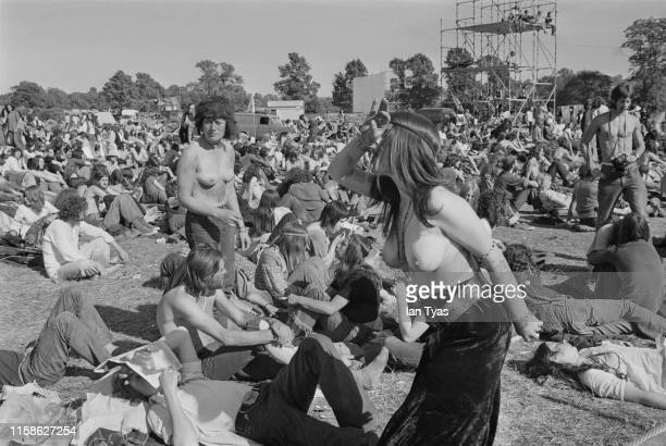 Topless women fans wearing body paint dancing in the audience at the Glastonbury Fair music festival 22nd 26th June 1971 Later renamed the...