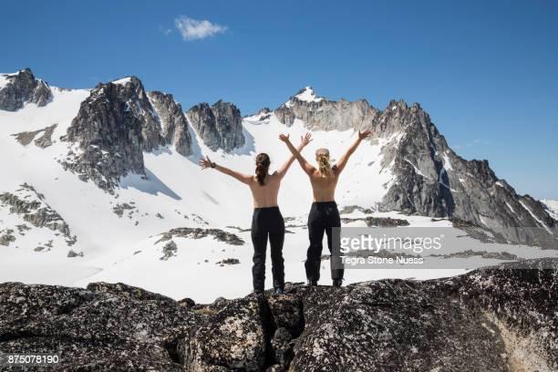 Topless Women on a mountain peak