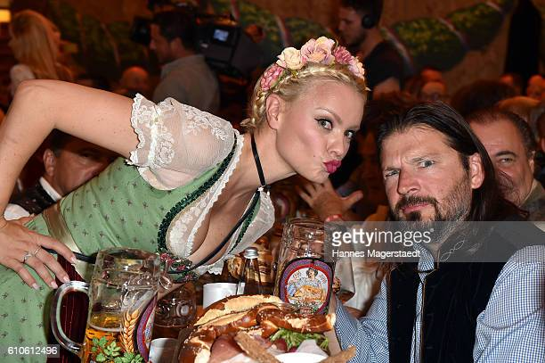 Topmodel Franziska Knuppe and her husband Christian Moestl during the Oktoberfest attend the BILD Wiesn at Marstall Festzelt during the Oktoberfest...