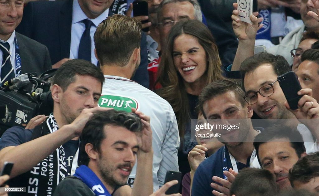 Top-model Izabel Goulart greets and kisses boyfriend goalkeeper of PSG Kevin Trapp while on his way to the trophy ceremony following the French Cup final (Coupe de France) between Les Herbiers VF and Paris Saint-Germain (PSG) at Stade de France on May 8, 2018 in Saint-Denis near Paris, France.