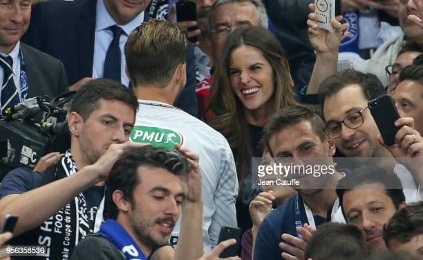 Topmodel Izabel Goulart greets and kisses boyfriend goalkeeper of PSG Kevin Trapp while on his way to the trophy ceremony following the French Cup...