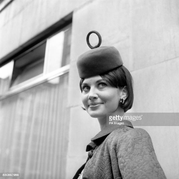 Topped by a ring is this pert pillbox hat worn by Pat Coombs at a showing in London as part of the ChristianDior London collection