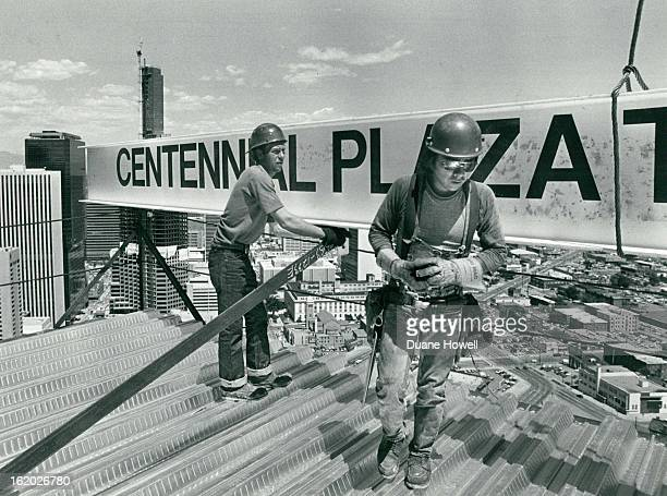 61982 Topping out of the Centennial Plaza 18th Sherman St at right is stellwork Johnson Lee who hocked up the steel I beam at the bottom of the...