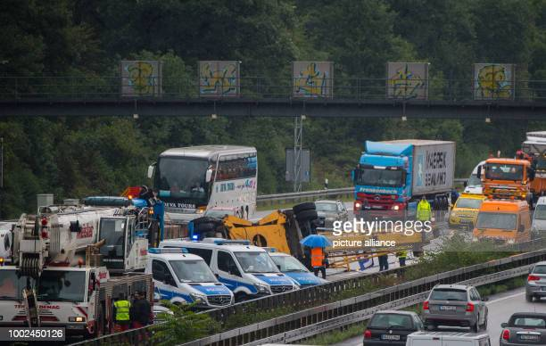A toppled construction crane on the Autobahn 3 motorway in Frankfurt am Main Germany 25 July 2017 The crane can be seen blocking traffic on the A3...