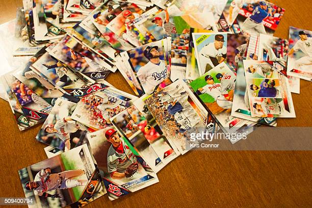Topps' baseball cards from the 2016 season are on display during the 'Open Topps Baseball Series 1 Cards ' event at the Topps' offices on February 10...