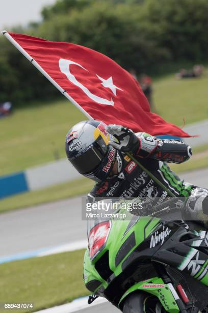 Toprak Razgatlioglu of Turkey and Kawasaki Puccetti Racing celebrates the victory with the flag at the end of the SuperStock1000 race during the FIM...