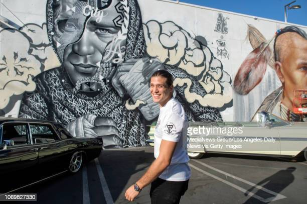 Topranked UFC featherweight Brian Ortega smiles after seeing a mural of himself in Los Angeles Monday Nov 5 2018 The painting created by artists...