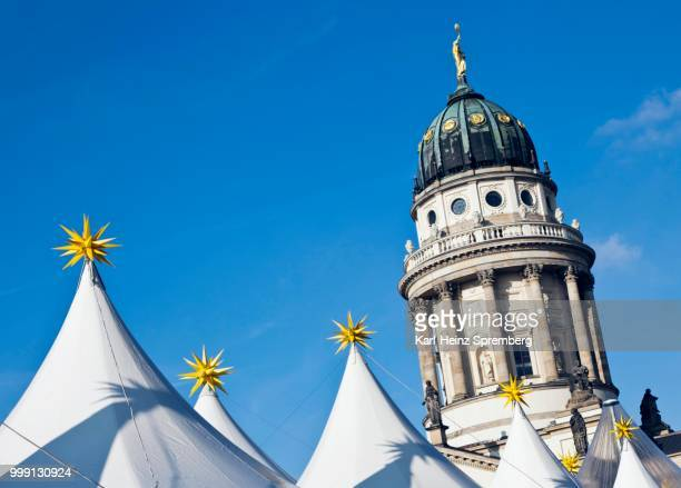 tops of the tents of the berlin christmas market in front of the konzerthaus berlin concert hall on gendarmenmarkt square, berlin, germany - konzerthaus berlin stock pictures, royalty-free photos & images