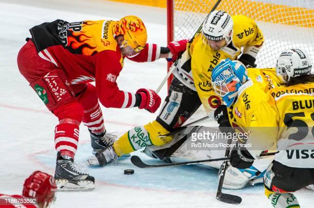 TopScorer Dustin Jeffrey of Lausanne HC tries to score against Goalie Tomi Karhunen and Yanik Burren of SC Bern during the Swiss National League game...