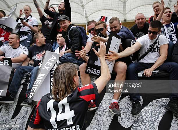 Topscorer of Frankfurt Alex Meier celebrates with fans after the Bundesliga match between Eintracht Frankfurt and Bayer 04 Leverkusen at...