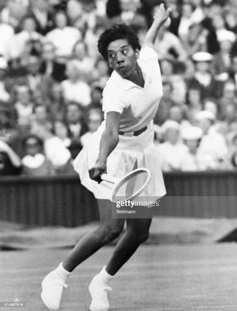 Top-seeded Althea Gibson of New York easily won her third round women's singles match by defeating Mary Hellyer of Australia, 6-4, 6-2. Althea, seeking to become the first black singles champion in Wimbledon history, is shown in action here on June 25th, when she defeated Mrs. Z. Kormoczy of Hungary during the first round, at 6-4, 6-4.