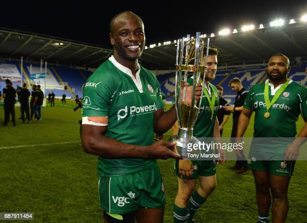 Topsy Ojo of London Irish celebrates with the trophy during the Greene King IPA Championship Final Second Leg match between London Irish and...