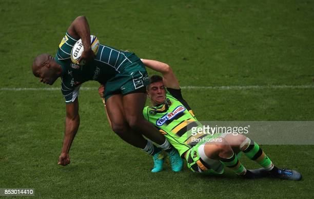 Topsy Ojo of London Irish is tackled by James Grayson of Northampton during the Aviva Premiership match between London Irish and Northampton Saints...
