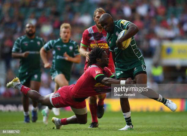 Topsy Ojo of London Irish is tackled by Marland Yarde of Harlequins during the Aviva Premiership match between London Irish and Harlequins at...