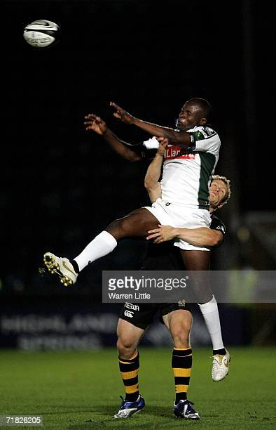 Topsy Ojo of London Irish is tackled in the air by Josh Lewsey of London Wasps during the Guinness Premiership match between London Wasps and London...