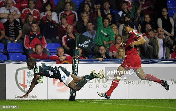 Topsy Ojo of London Irish scores a try during the Heineken Cup match between London Irish and Munster at the Madejski Stadium on October 9, 2010 in...