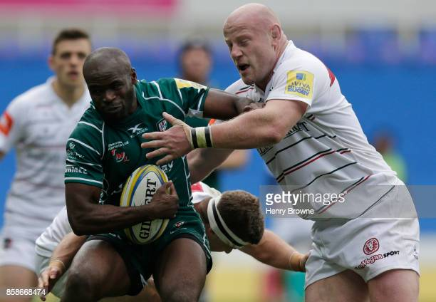 Topsy Ojo of London Irish tackled by Dan Cole of Leicester Tigers and Nick Malouf of Leicester Tigers during the Aviva Premiership match between...