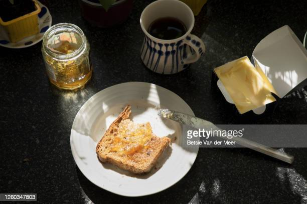 topview of still life of breakfast , toast with marmalde and coffee. - spread stock pictures, royalty-free photos & images