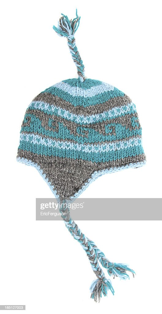 Toque with tassels on white : Stock Photo