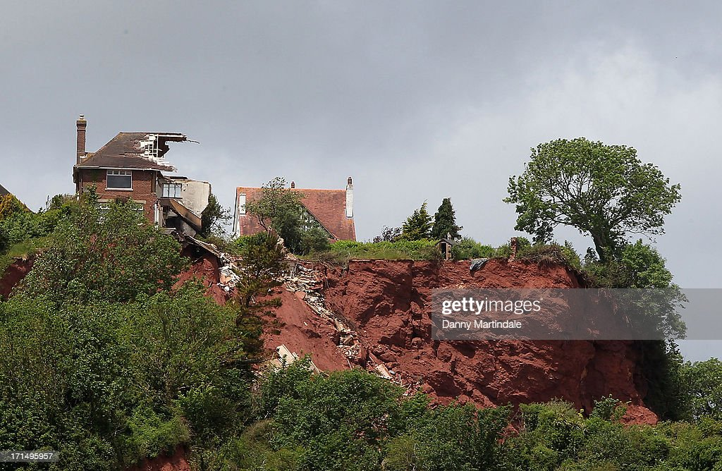 Tor Cottage, a four bedroom cliff-top home worth £400,000 (not seen) is seen on June 20, 2013 in Torquay, England. It is on the market for a mere £25,000 as it is at risk of falling into the sea the same way as the neighboring house has done.