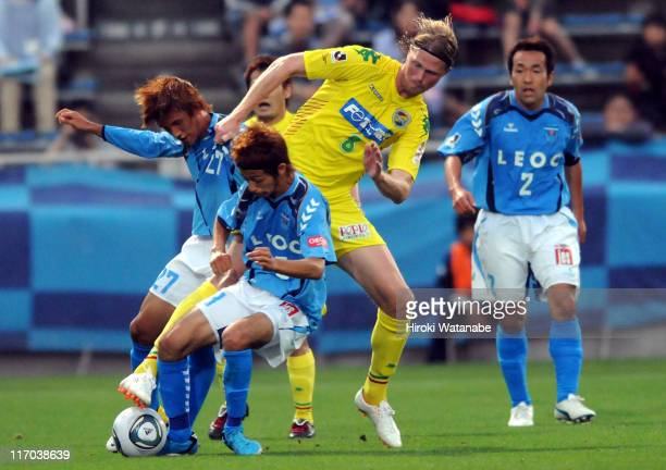 Tor Hogne Aaroy of JEF United Chiba compete for the ball with Kensuke Sato and Park Tae Hong of Yokohama FC during the JLeague second division match...