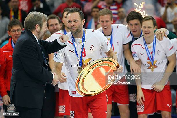Tor Lian, EHF president, hands out the EHF trophy to Lars Christiansen of Denmark on the podium after the Men's European Handball Championship final...