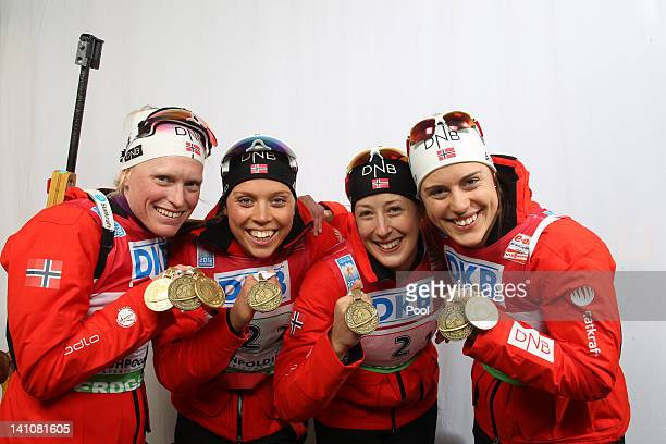 Tora Berger, Elise Ringen, Fanny Welle-Strand Horn and Synnoeve Solemdal of Norway show their medals of the Women's 4 x 6km Relay with her team mate...