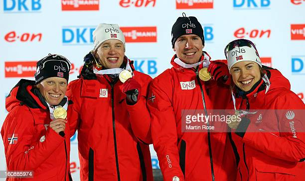 Tora Berger Emil Hegle Svendsen Tarjei Boe and Synnoeve Solemdal of Norway pose with the gold medal after winning the IBU Biathlon World...