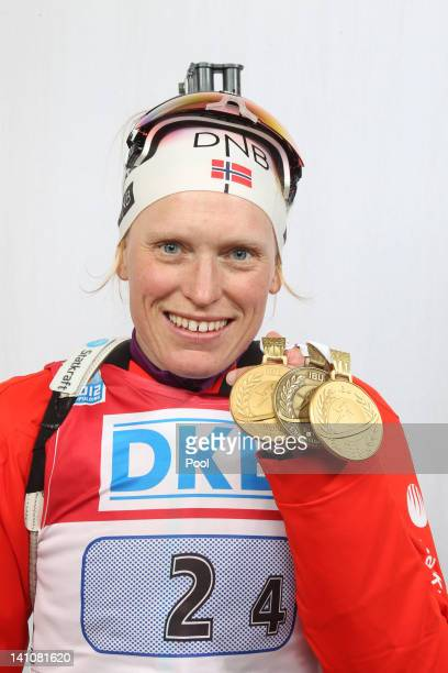 Tora Berger of Germany shows her medals of the Women's 4 x 6km Relay during the IBU Biathlon World Championships at Chiemgau Arena on March 10, 2012...