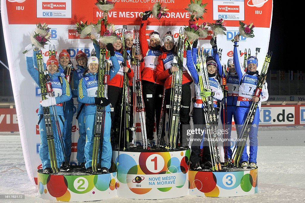Tora Berger of Norway 1st place, Hilde Fenne of Norway takes 1st place, Ann Kristin Aafedt Flatland of Norway takes 1st place, Synnoeve Solemdal of Norway 1st place, Olena Pidhrushna of Ukraine takes 2nd place, Juliya Dzhyma of Ukraine 2nd place, Vita Semerenko of Ukraine 2nd place, Valj Semerenko of Ukraine 2nd place, Dorothea Wierer of Italy takes 3rd place, Michela Ponza of Italy takes 3rd place, Karin Oberhofer of Italy takes, Nicole Gontier of Italy takes 3rd place during the IBU Biathlon World Championship Women's 4x6km Relay on February 15, 2013 in Nove Mesto, Czech Republic.