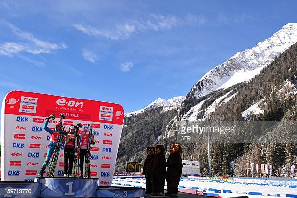 Tora Berger of Norway celebrates on the podium with second placed Olena Pidhrushna of Ukraine and third placed Kaisa Makarainen of Finland on the...