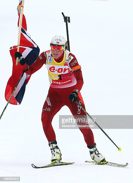 Tora Berger of Norway celebrates winning the women's 12,5km mass start event during the IBU Biathlon World Cup at Chiemgau Arena on January 13, 2013...